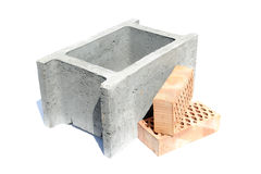 Shuttering block and two bricks Royalty Free Stock Photos