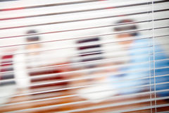 Shutters. Image of shutters in the office and silhouettes behind them royalty free stock images