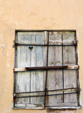 Shutters. Old shutters with heart carved in them Royalty Free Stock Photo