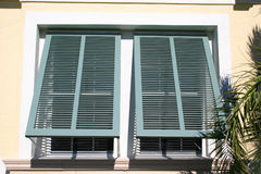 Shutters. Open shutters, letting in breezes and sunshine in the tropics (View 2 stock photos