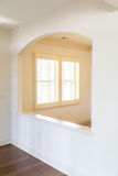 Shutters Through Arch. White Plantation Shutters in a new home royalty free stock photo