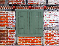 Shutters in brick wall of half timbered house Royalty Free Stock Photos