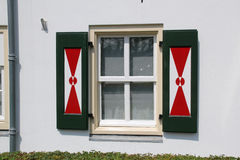 Shutters on Dutch windows with traditional red and white design Royalty Free Stock Photography