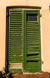 Shutters old damaged repaired Royalty Free Stock Photos