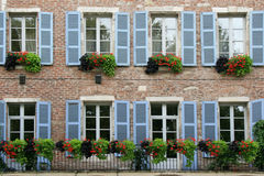 The shutters of an old stone house situated in Cahors, France, were painted in blue Stock Photos