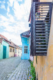 Shutters Open. On a cobblestone street Royalty Free Stock Photos