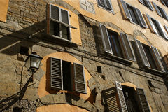 Shutters and shadows. A street in Florence, Italy late in the day as the sun goes down royalty free stock photos