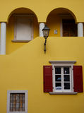 Shutters and Terrace. Front of a house in Italy Royalty Free Stock Images