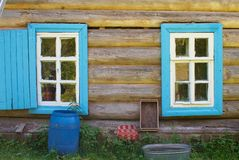 Shutters on wooden house Stock Image