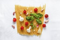 Background stock, cooking pasta, wooden background, egg yolk, still life, stock photo, olive oil, pasta tomato,. Set of products for cooking traditional Italian royalty free stock image