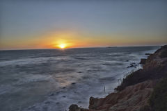 Shutting the day. Sunset from the cliffs to the beach La Barrosa Royalty Free Stock Photos
