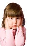 Shutting ears. Scared little girl Shutting ears isolated stock photos