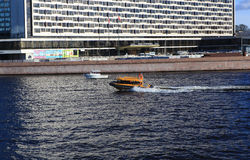 Shuttle boat speeds along the Neva River, St. Petersburg Royalty Free Stock Images