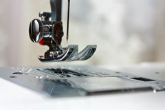 Shuttle close-up of needle in a sewing machine Royalty Free Stock Images