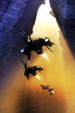 Shuttle coming out. Science fiction shuttle coming out of a rocky cave Royalty Free Stock Photo