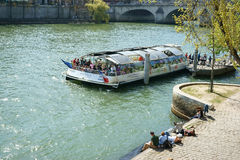 A shuttle excursion boat Seine river Paris Royalty Free Stock Image
