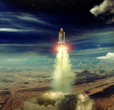Shuttle launch. Ancient shuttle starting its trip to space Stock Photo