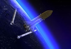 Shuttle in space. The Space shuttle leaving his reservoirs of fuel Royalty Free Stock Photography
