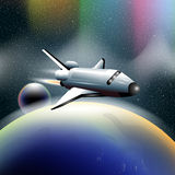 Shuttle in space flying from planet earth, orbiting a blue planet. Royalty Free Stock Photography