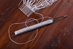 Shuttle for tying fishing nets Royalty Free Stock Images
