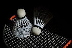 Shuttlecock on badminton playing court at nigh stock photos
