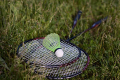 Shuttlecock and badminton racket Stock Photos