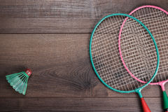 Shuttlecock and badminton racket. On wooden background Royalty Free Stock Photo