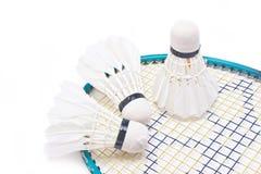 Shuttlecock with badminton racket. Shuttlecock with badminton racket isolated on white background Royalty Free Stock Image