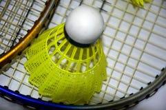 Shuttlecock and badminton racket stock photos