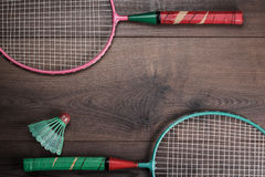 Shuttlecock and badminton racket. S on wooden background Royalty Free Stock Photos