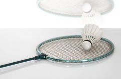 Shuttlecock on badminton racket. Stock Image