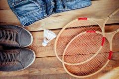 Shuttlecock on badminton racket Stock Images