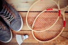 Shuttlecock on badminton racket Stock Photos