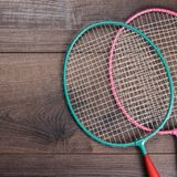 Shuttlecock and badminton racket. On wooden background Stock Photography