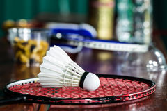Shuttlecock on badminton rackets Royalty Free Stock Image