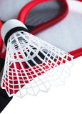 Shuttlecock on badminton rackets. On white background Royalty Free Stock Photo