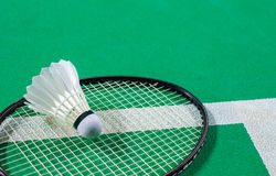 Shuttlecock on badminton racquet Stock Images