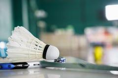 Shuttlecock for badminton sport games on racket Stock Image