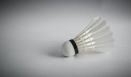 Shuttlecock. A badminton shuttlecock on white background with shadows Royalty Free Stock Photo