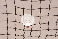 Shuttlecock captive in a badminton net. Sport items Royalty Free Stock Photography