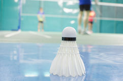 shuttlecock on the floor with badminton player Stock Image