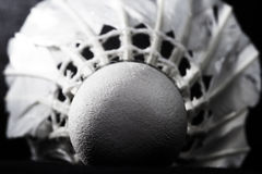 Shuttlecock from goose feathers on a black background Royalty Free Stock Photography
