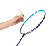 Shuttlecock in hand isolated on badminton racket background Stock Photo