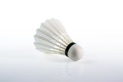 Shuttlecock with parts of its feathers scattered on white Royalty Free Stock Photo