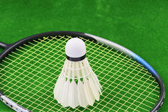 The Shuttlecock and Racket badminton on green background Royalty Free Stock Image