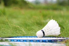 Shuttlecock and rackets for badminton on the green grass. Summer game for healthy lifestyle royalty free stock images