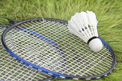 Shuttlecock and rackets on the green grass. Stock Photography