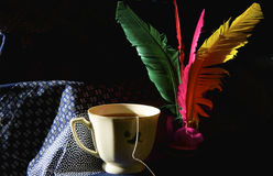 Shuttlecock and tea cup Stock Photo
