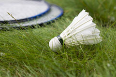 Shuttlecock with two rackets for badminton on the grass. Active summer holiday outdoors stock photo