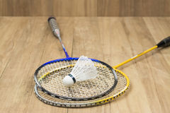 Shuttlecock and two racquets Stock Images